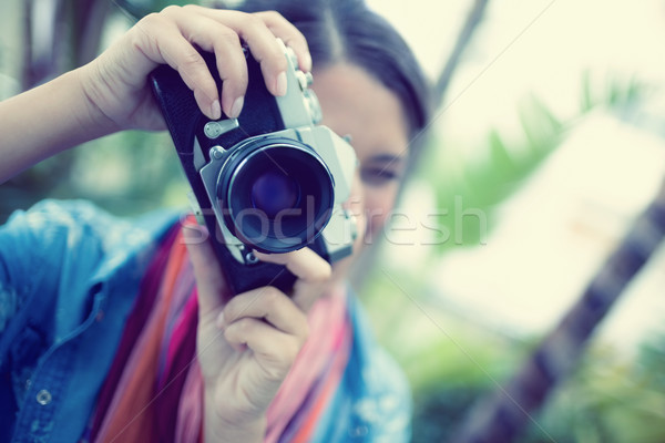 Brunette taking a photo outside looking at camera Stock photo © wavebreak_media