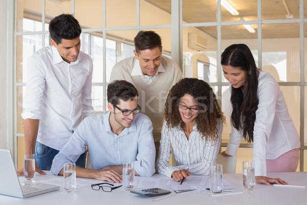 Casual business team working together at desk Stock photo © wavebreak_media