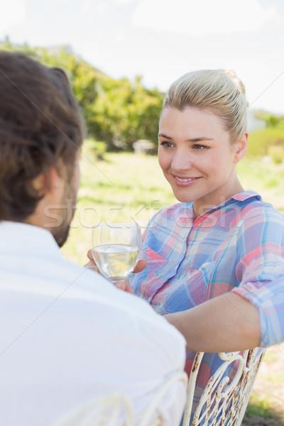 Happy young couple sitting in the garden enjoying wine together Stock photo © wavebreak_media