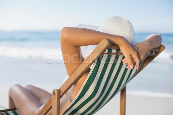 Karcsú nő megnyugtató fedélzet szék tengerpart Stock fotó © wavebreak_media