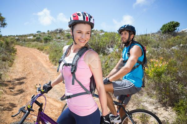 Dopasować para rowerowe w górę górskich szlak Zdjęcia stock © wavebreak_media