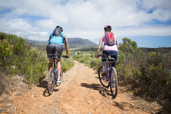 Fit couple cycling on mountain trail Stock photo © wavebreak_media