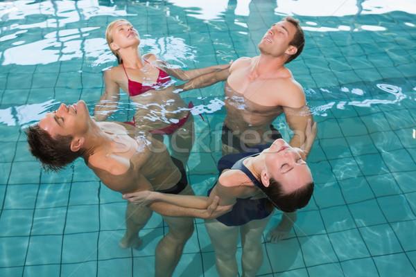 Happy fitness class stretching in aqua aerobics Stock photo © wavebreak_media