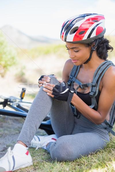 Fitt nő tart sebesült térd bicikli Stock fotó © wavebreak_media