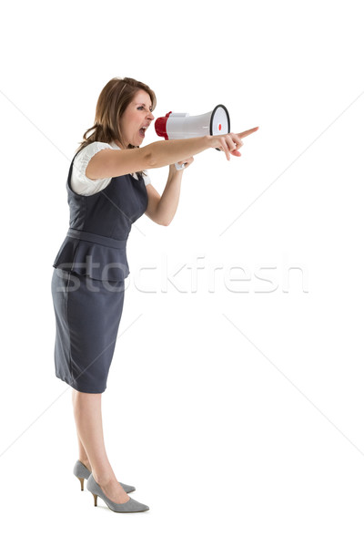 Young woman shouting into bullhorn as she gestures Stock photo © wavebreak_media