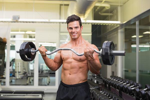 Uśmiechnięty półnagi muskularny człowiek sztanga Zdjęcia stock © wavebreak_media