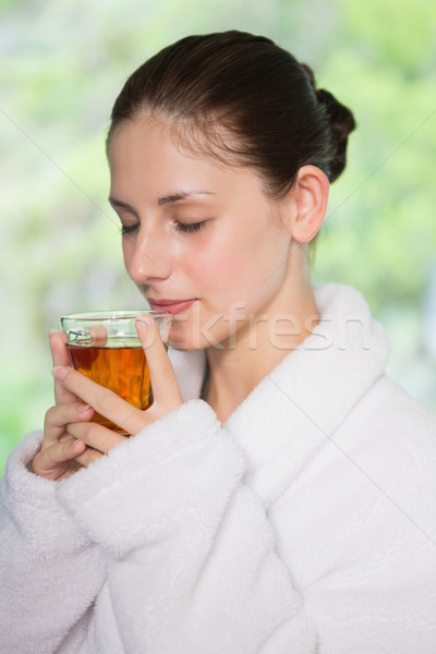 Güzel bir kadın bornoz çay güzel genç kadın Stok fotoğraf © wavebreak_media