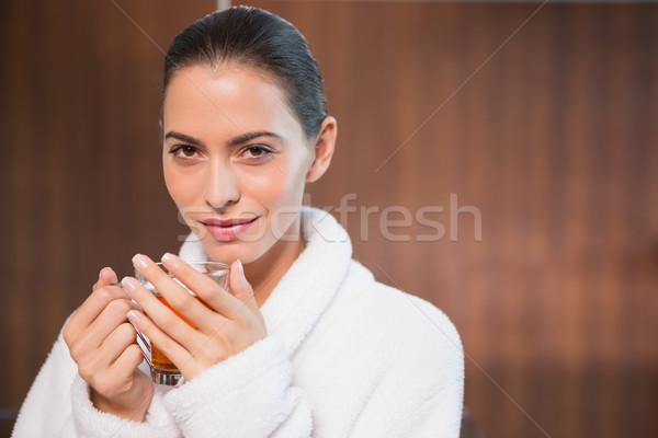 Mujer hermosa albornoz té retrato hermosa Foto stock © wavebreak_media