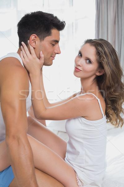 Romantic couple sitting in bed at home Stock photo © wavebreak_media