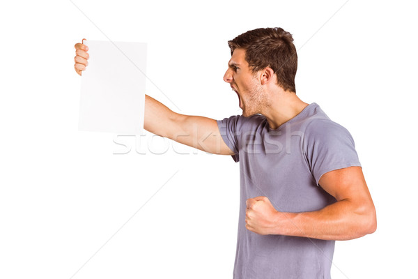 Angry man shouting at piece of paper Stock photo © wavebreak_media