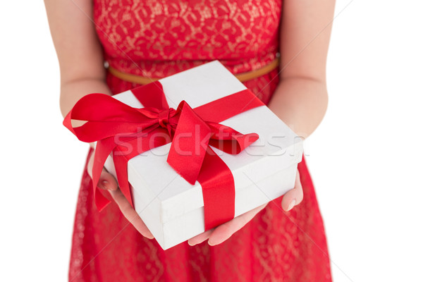 Mujer bonita vestido rojo ofrecimiento presente blanco belleza Foto stock © wavebreak_media