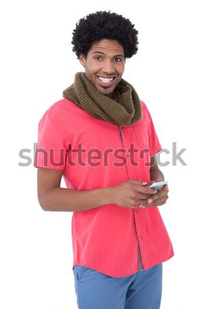 Smiling man standing and text messaging  Stock photo © wavebreak_media