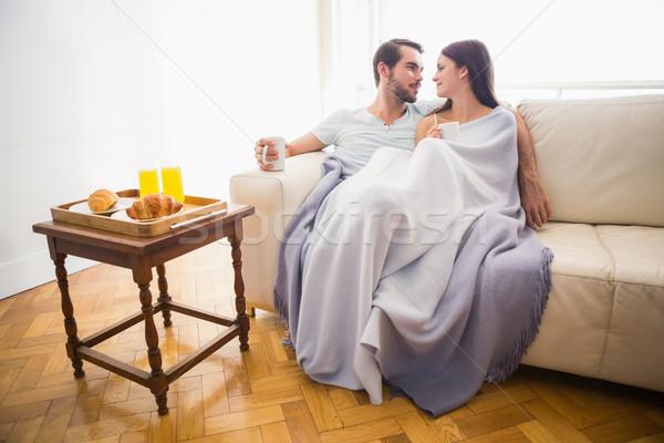 Bonitinho casal relaxante sofá cobertor casa Foto stock © wavebreak_media