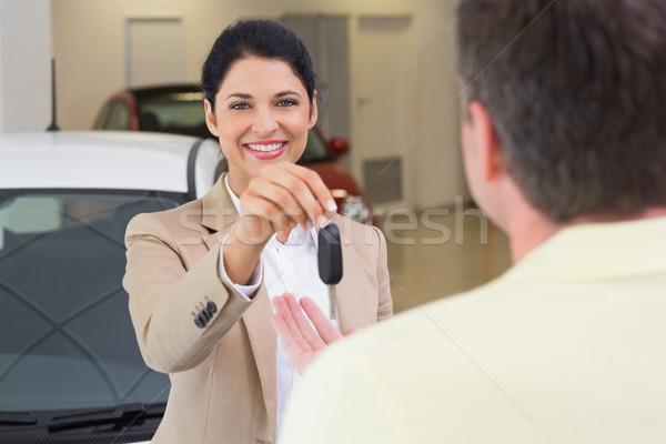 Smiling businesswoman giving car key to happy customer Stock photo © wavebreak_media
