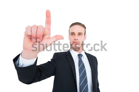 Unsmiling businessman in suit pointing up his finger Stock photo © wavebreak_media
