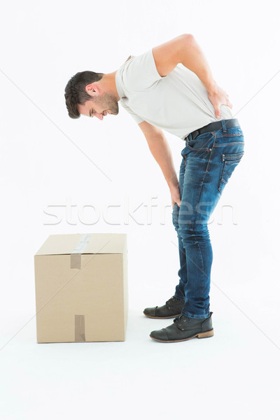 Side view of delivery man suffering from back pain Stock photo © wavebreak_media