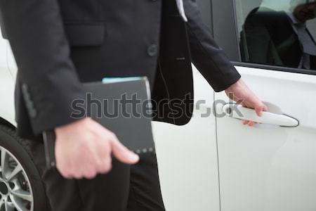 Férfi tart autó ajtó vágólap új autó Stock fotó © wavebreak_media