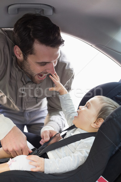 Father securing baby in the car seat Stock photo © wavebreak_media