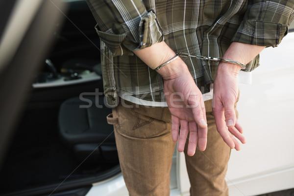 Close up of handcuffed man Stock photo © wavebreak_media