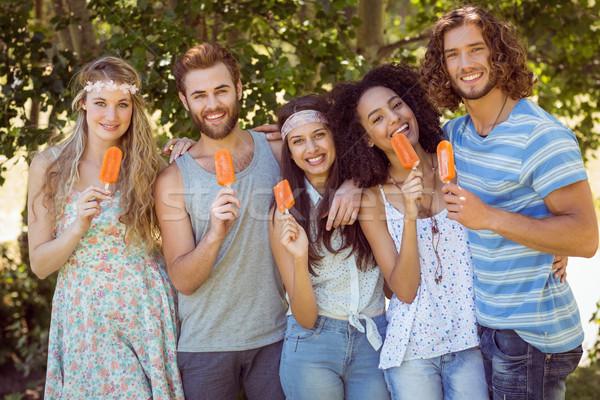 Hipster friends enjoying ice lollies Stock photo © wavebreak_media
