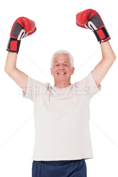 Starszy człowiek rękawice bokserskie biały szczęśliwy fitness Zdjęcia stock © wavebreak_media