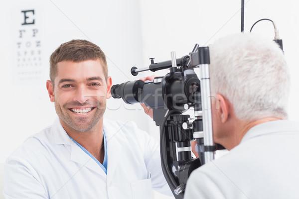 Boldog optometrikus megvizsgál idős szem portré Stock fotó © wavebreak_media