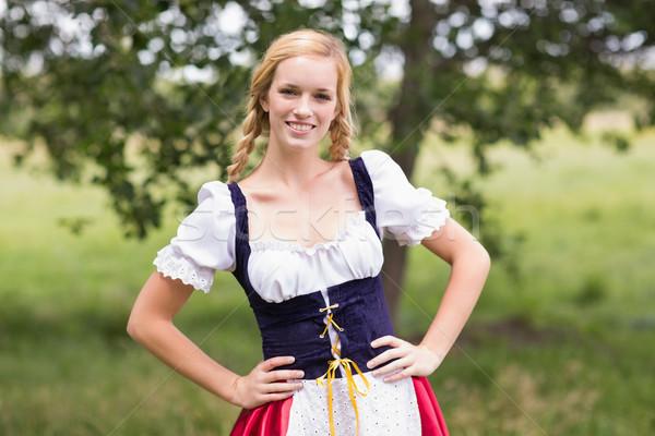 Joli oktoberfest fille souriant caméra Photo stock © wavebreak_media