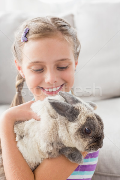 Girl playing with rabbit in living room Stock photo © wavebreak_media