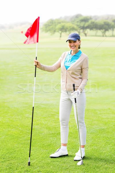 Femenino golfista sonriendo cámara campo de golf Foto stock © wavebreak_media