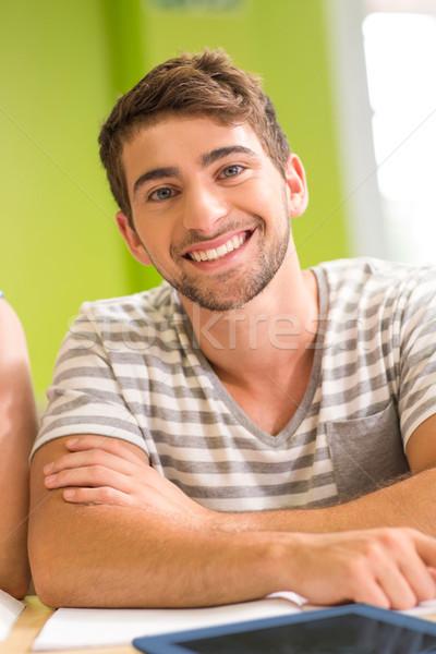 Stockfoto: Portret · gelukkig · mannelijke · student · bibliotheek · huiswerk