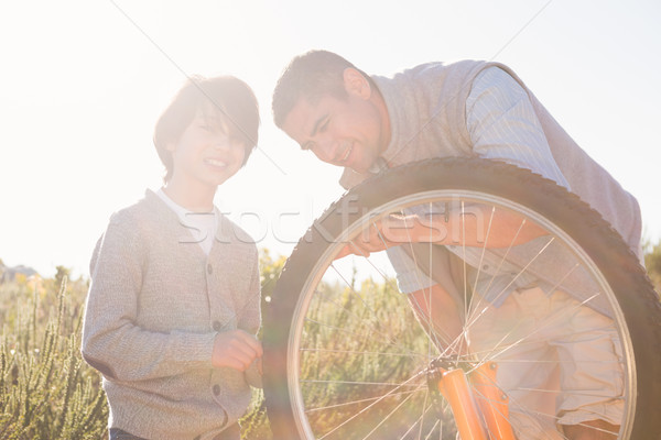 Hijo de padre moto junto hombre Foto stock © wavebreak_media