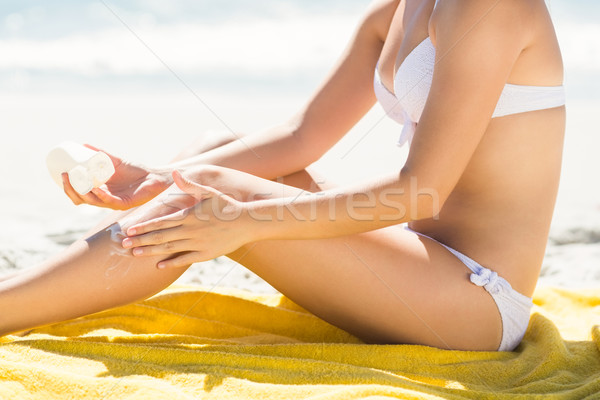 Close up view of Pretty blonde woman putting sun tan lotion on h Stock photo © wavebreak_media