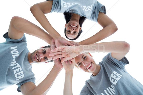 Happy volunteers putting their hands together  Stock photo © wavebreak_media
