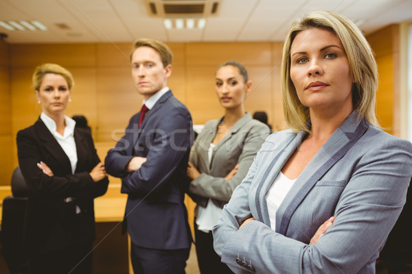 Serious lawyer standing with arms crossed Stock photo © wavebreak_media