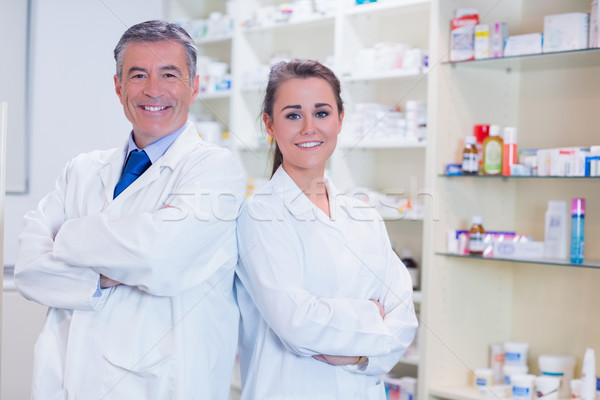 Pharmacist with his trainee standing with arms crossed Stock photo © wavebreak_media