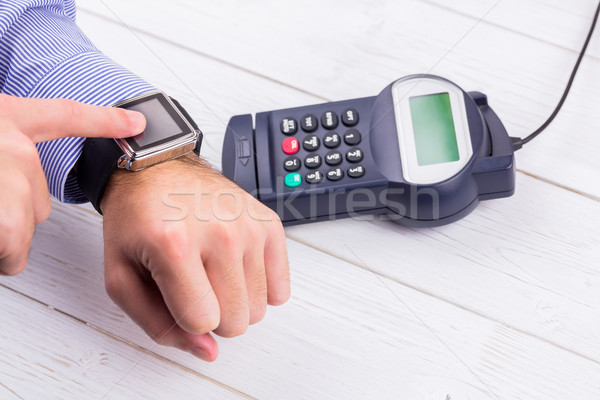 Man using smart watch to express pay  Stock photo © wavebreak_media