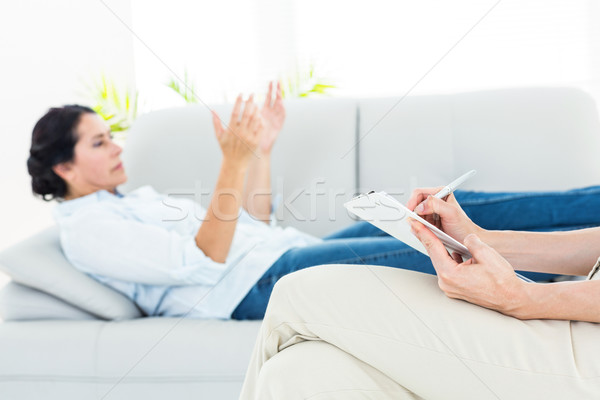 Therapist listening her patient and taking notes Stock photo © wavebreak_media