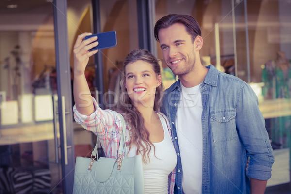 A smiling happy couple taking selfies Stock photo © wavebreak_media