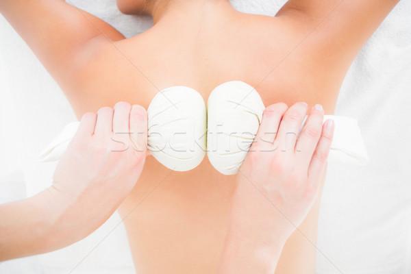 Woman enjoying a herbal compress massage Stock photo © wavebreak_media