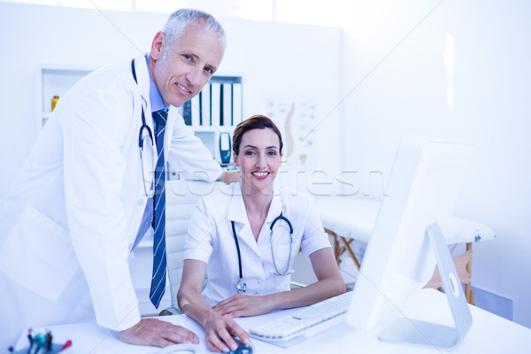 Portrait of smiling medical colleagues working with computer and Stock photo © wavebreak_media