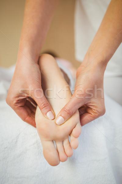 Young woman getting foot massage Stock photo © wavebreak_media