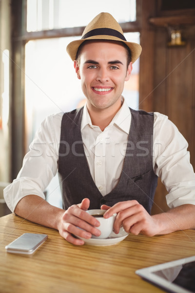 Smiling hipster with cup of coffee Stock photo © wavebreak_media