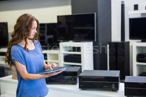 Pretty woman shopping for new electronics Stock photo © wavebreak_media