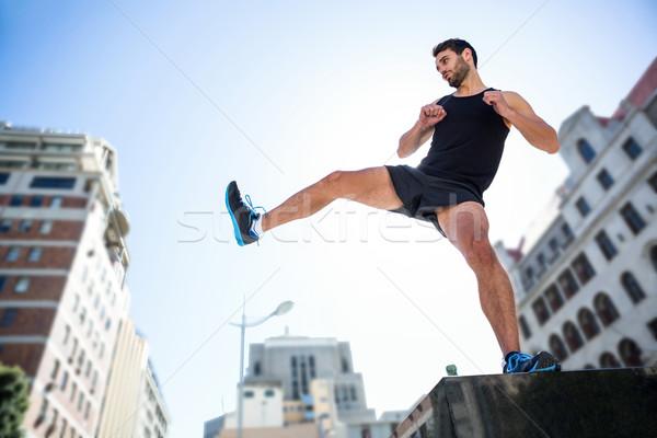 Przystojny sportowiec powietrza miasta Zdjęcia stock © wavebreak_media