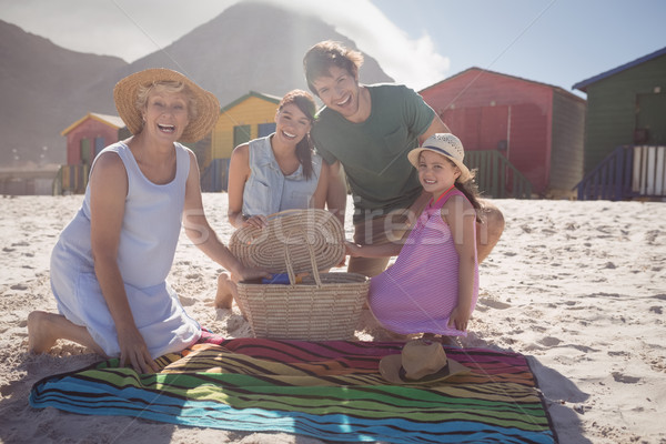 портрет счастливым семьи пикник одеяло пляж песок Сток-фото © wavebreak_media