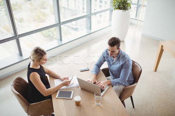 Stock photo: Overhead view of executives working at desk