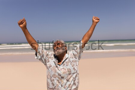 Rear view of woman with arms outstretched standing against clear sky  Stock photo © wavebreak_media