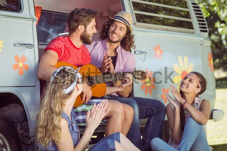 Happy friends enjoying while sitting in motor home Stock photo © wavebreak_media