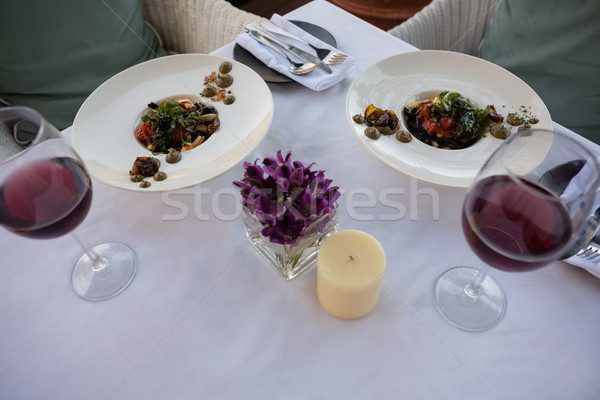 Food and drinks served on decorated table in restaurant Stock photo © wavebreak_media
