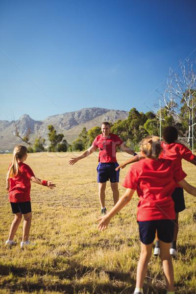 Entraîneur formation enfants démarrage camp Photo stock © wavebreak_media
